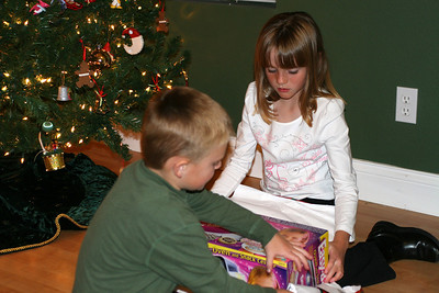 Christopher helping Sydney open her Easy-Bake Oven, which was a gift from the Moore family.