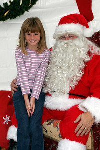 Sydney getting to visit with Santa at a Toys for Tots donation site.