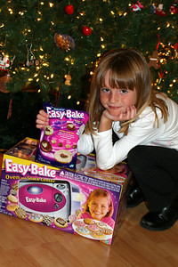 Sydney showing off an Easy-Bake Oven, which was a gift from the Moore family.