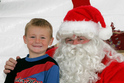 Christopher getting to visit with Santa at a Toys for Tots donation site.