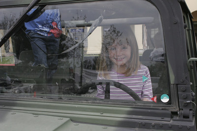 Sydney test driving a USMC HMMWV after visiting with Santa at a Toys for Tots donation site.
