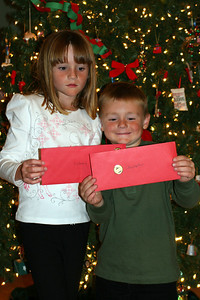 """Christopher and Sydney showing off their Toys""""R""""Us gift cards, which were a gift from Aunt KK."""