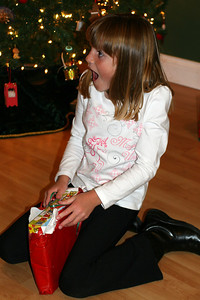 Sydney was really excited once she saw what Christopher had picked out for her--a box of stickers.