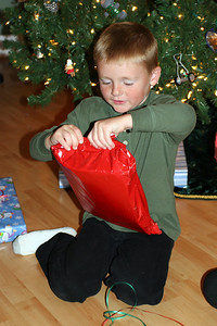 Christopher opening his gift from Sydney.
