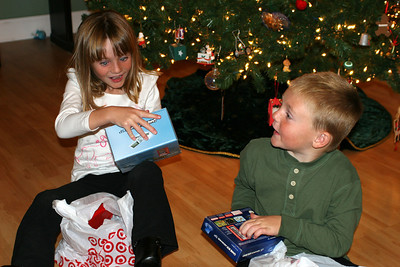 Sydney and Christopher opening their Game Boy Advances, which were gifts from Kathy and Pat, though Pat really wasn't consulted on it and was still under the impression that video games weren't a part of this Kane household (at least that used to be what Kathy said)  :-)