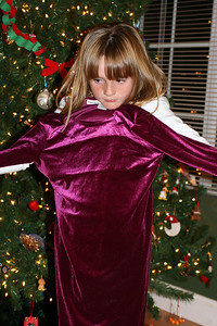 Sydney showing off her burgundy dress, which was a gift from the Basil family.