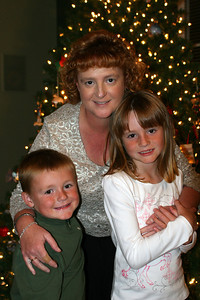 Kathy, Sydney and Christopher on Christmas Eve getting ready to open their Christmas gifts.
