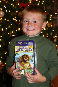 Christopher showing off his Madagascar game cartridge for the Leapster, which was a gift from Grandma.