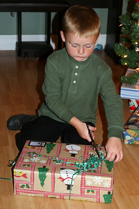 Christopher opening his gift from Rachel, Aunt Tracy & Uncle John.