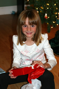 Sydney opening her gift from Aunt Betsy, which just happened to be game cartridges for her new Game Boy Advance.