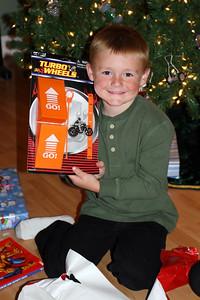 Christopher showing off his stunt motorcycle, which was a gift from Sydney.