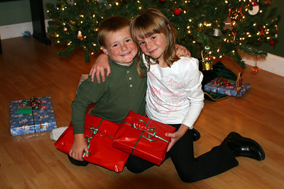 Christopher and Sydney exchanging their Christmas gifts. Each put a lot of thought this year into what the other might enjoy.