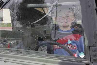 Christopher test driving a USMC HMMWV after visiting with Santa at a Toys for Tots donation site.