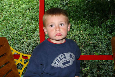 """""""What, this isn't a roller coaster?!"""" as Christopher gets seated on the Disneyland Railroad."""