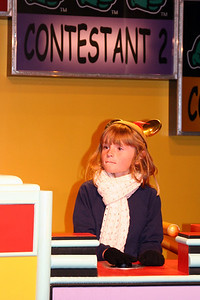 Sydney playing a TiVo trivia contest inside Innoventions.