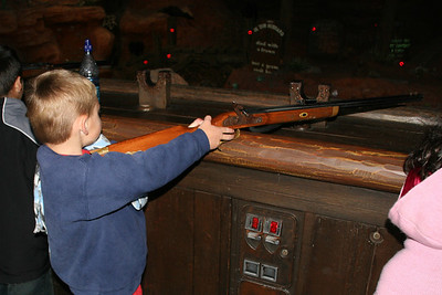 Christopher enjoying target practice at the Frontierland Shootin' Arcade while the girls were off enjoying the Indiana Jones Adventure (Christopher was just a little too short for the ride).