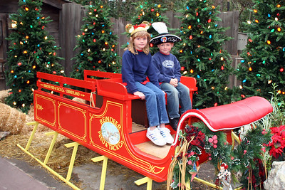 Sydney and Christopher on Santa's sleigh outside of Big Thunder Ranch.