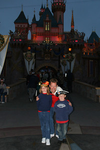 Sydney, Pat and Christopher in front of Sleeping Beauty Castle.