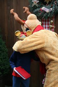Sydney getting a big hug from Pluto.