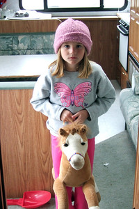 Sydney with her stuffed pony, taking a break in our fifth wheel at El Capitan State Beach.