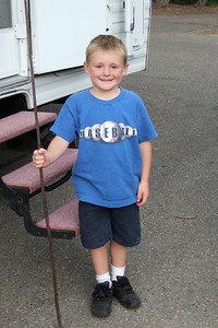 One of the first things that Christopher does when we go camping is find a walking stick.