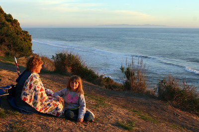 Kathy and Sydney are watching for dolphins and getting ready for the sunset at El Capitan State Beach.