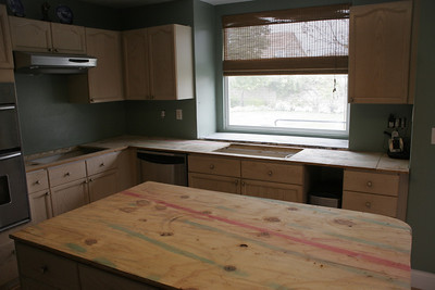 The tile counter tops and backsplash have been removed and the kitchen is now ready for the granite counter tops to be installed.