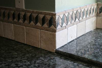 Pat installed the tumbled marble back splash after the contractors installed the granite counter tops.