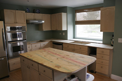 The tile counter tops and back splash have been removed and the kitchen is now ready for the granite counter tops to be installed.
