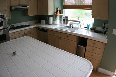 We've never really liked the tile counter tops, so we're going to replace them with granite.