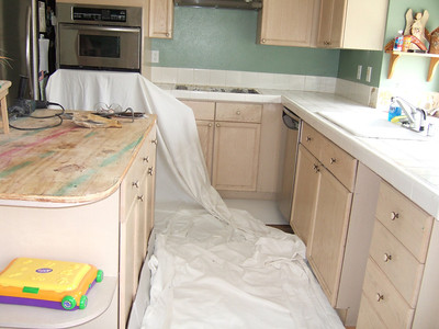 Pat is getting ready to demo the tile counter tops as we're replacing them with granite.
