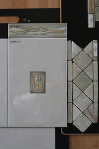 These are the Italian tiles that will be used for the tub backsplash and shower walls. We didn't like the golden inlay or border tile, so we went with plain tiles and the Onyx border tile instead.
