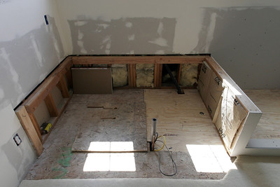 The master bath is starting to come back together, with the rotted floor replaced and the drywall installed. I've yet to frame in the area for the drop-in tub.