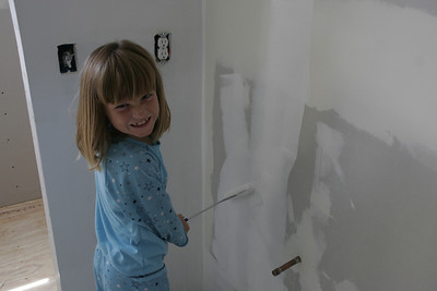 Sydney applying primer to the walls in the master bath.
