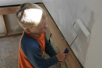 Christopher applying primer to the walls in the master bath.