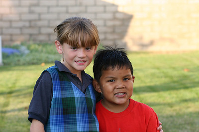 Sydney and Isaac hanging out in our backyard.