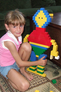 Sydney showing off the Duplo person she created.