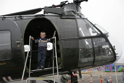 Christopher standing in the doorway of a 1957 Vertol H-21B Shawnee tandem rotor helicopter, a.k.a. the Flying Banana, that was flown to the 41st NAS Point Mugu Air Show by Classic Rotors,  http://www.rotors.org/