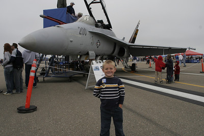 Christopher in front of a F/A-18 Hornet at the 41st NAS Point Mugu Air Show.