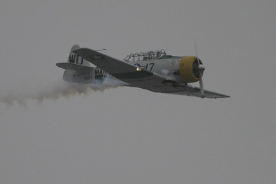 "A North American AT-6/SNJ Texan being piloted by John A. Collver during the 41st NAS Point Mugu Air Show. His ""wardog performance"" gave us a first hand look at what U.S. fighter pilots were taught during World War II."