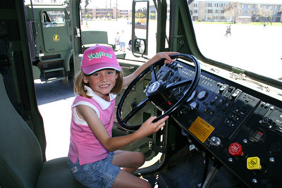 Sydney at the wheel of a Medium Tactical Vehicle Replacement (MTVR) during Seabee Days.