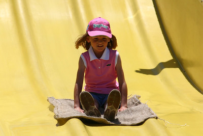 Sydney coming down a big slide during the Seabee Days festivities.