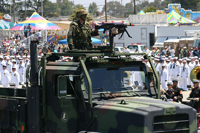 Seabee manning the 50-cal machine gun on a Medium Tactical Vehicle Replacement (MTVR) in the Seabee Days parade