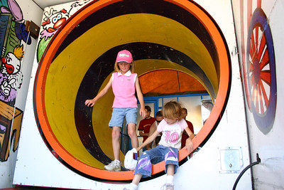Sydney coming through a rotating tunnel during the Seabee Days festivities.