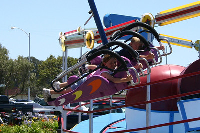 Sydney and Christopher flying high on one of the rides during the Seabee Days festivities