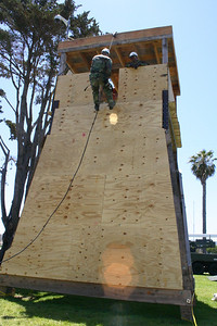Seabee rappelling from guard tower during Seabee Days