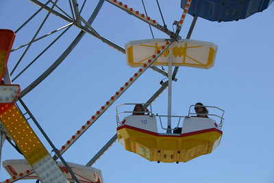 Sydney having fun on the ferris wheel during Seabee Days. Unfortunately Christopher was just a little too short to ride.