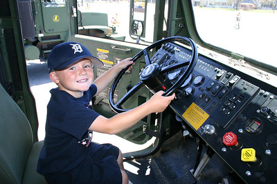 Christopher at the wheel of a Medium Tactical Vehicle Replacement (MTVR) during Seabee Days.