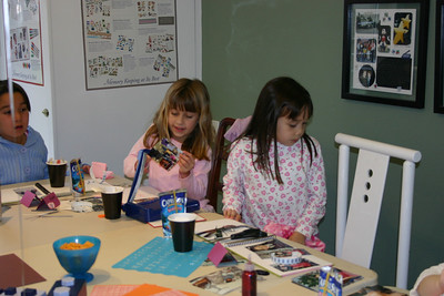 For her 7th birthday party, Sydney had a bunch of friends over to scrapbook. Nicole and Sierra.