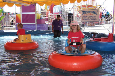Sydney and Christopher enjoying bumper boats at the 2005 Ventura County Fair.
